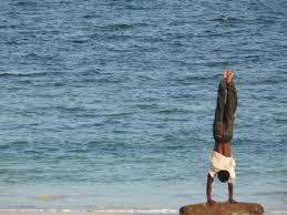 hand stand beach